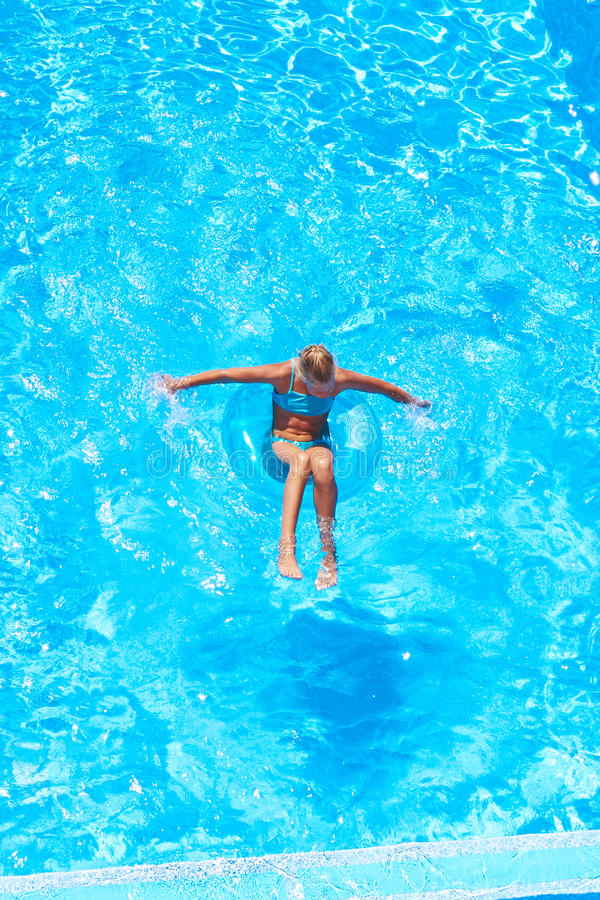 Girl swimming in pool. Teen girl swimming in the pool royalty free stock photo