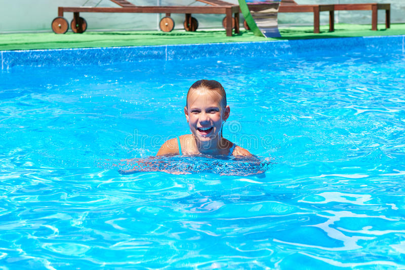 Girl swimming in pool. Teen girl swimming in the pool royalty free stock images
