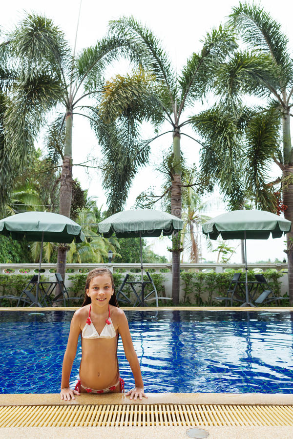 Girl in swimming pool. 8 years old girl playing in swimming pool at hotel royalty free stock image