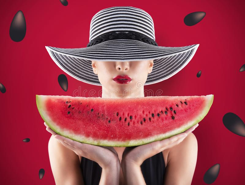 Girl in swimsuit with watermelon in hand and red background with seeds stock images