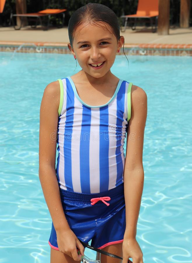 Girl in Swimsuit Has Pool Fun on Hot Summer Day royalty free stock photo