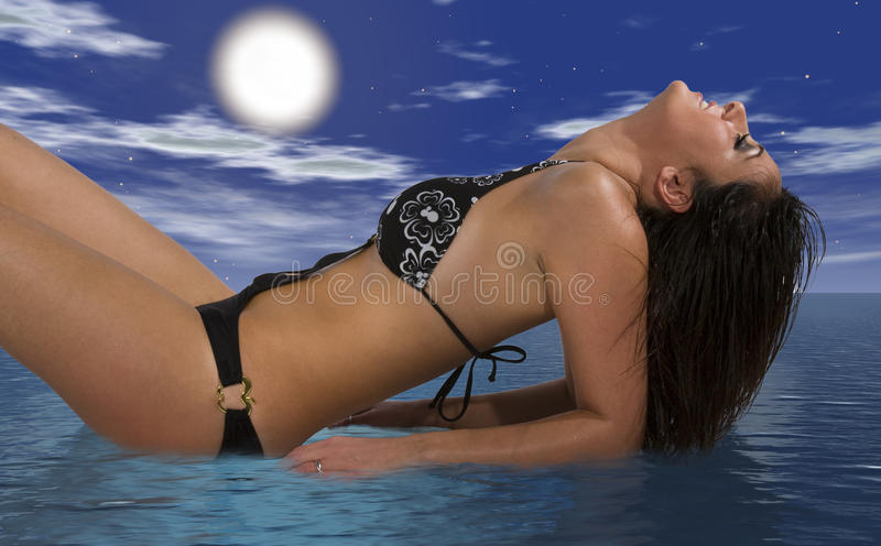 Girl swimsuit relaxing lying on the sea, head tilted back. Sky and clouds royalty free stock image