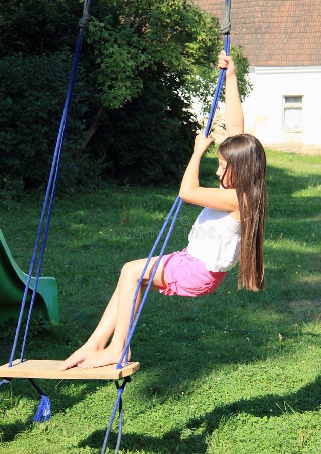 Kid - girl on swing stock photography