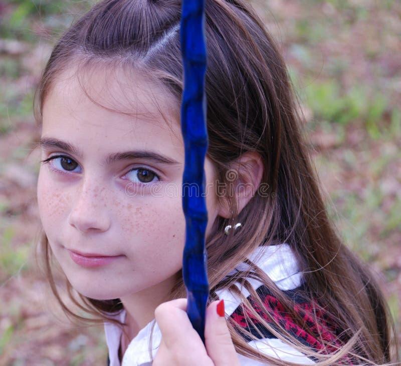 Girl Swinging. School girl on a swing who is having fun stock photos