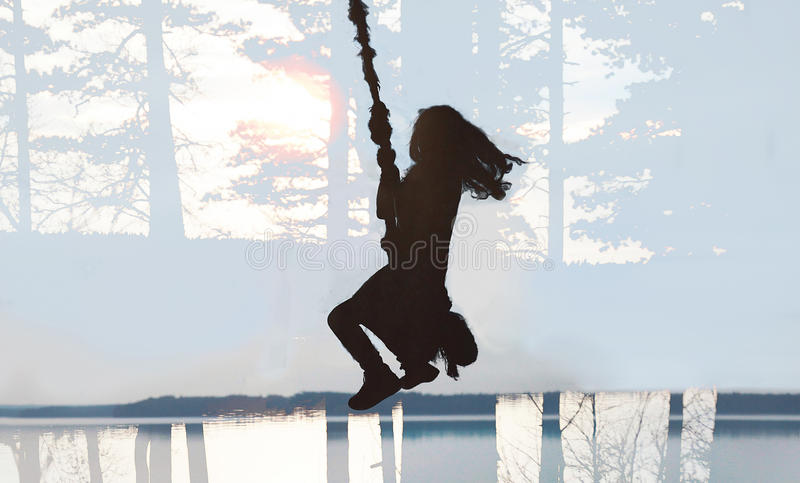 Girl swinging bungee royalty free stock photography