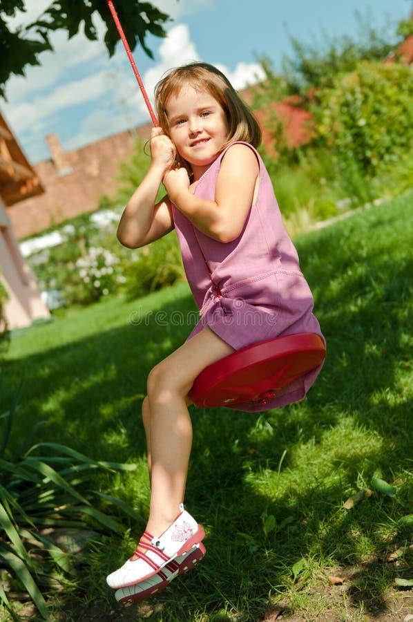 Download Girl Swinging On Seesaw Stock Photo - Image: 15578740