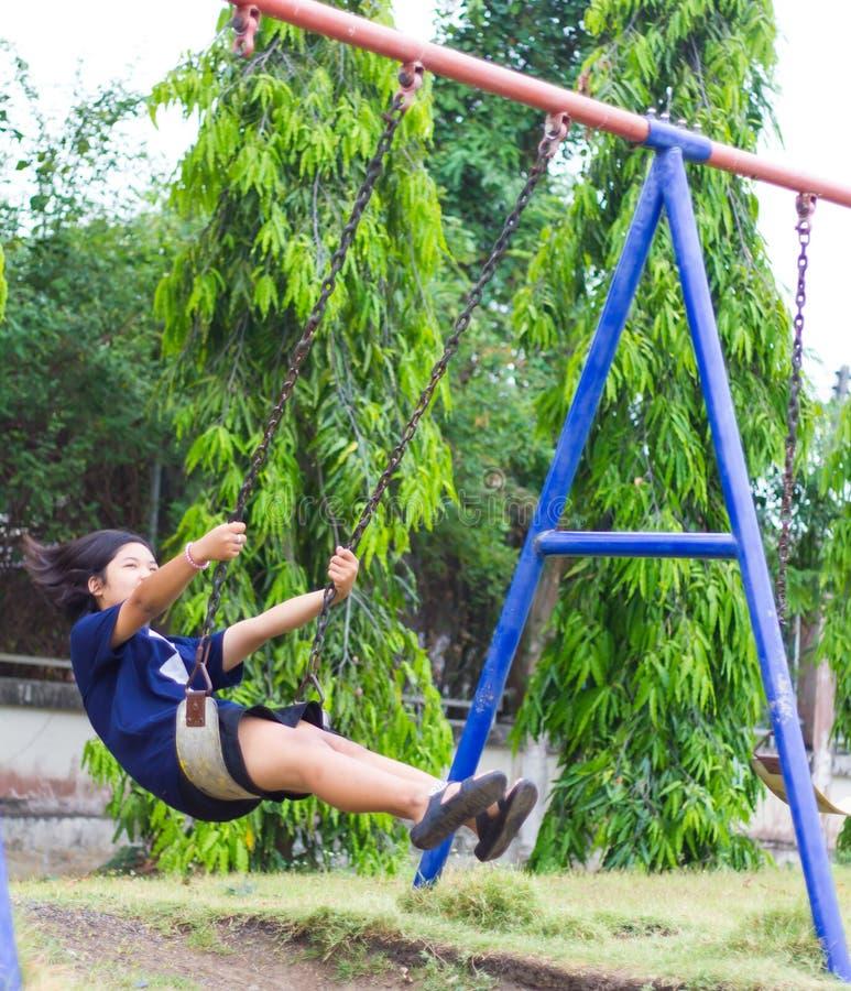 Girl swinging swing in the garden. royalty free stock photo