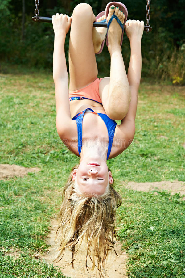 Girl swinging on a swing. Outdoors royalty free stock images