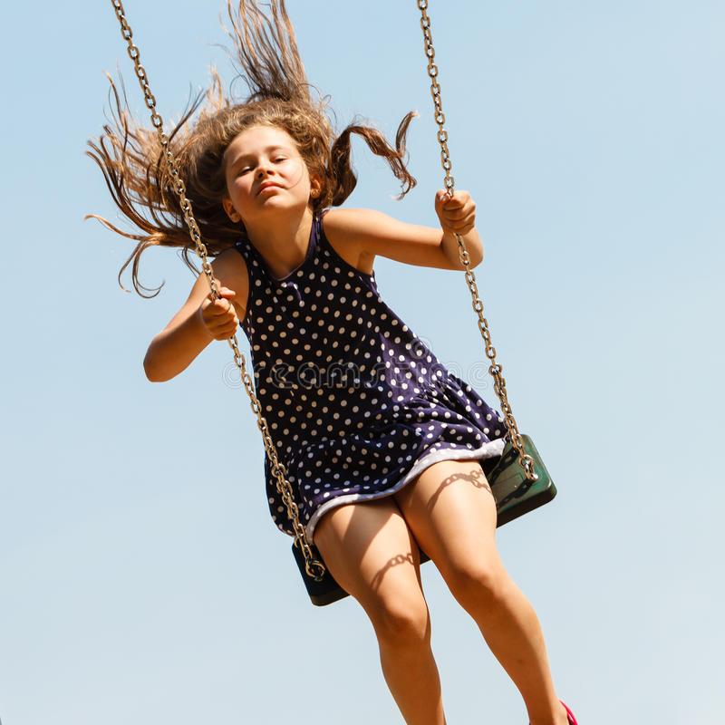 The girl is swinging