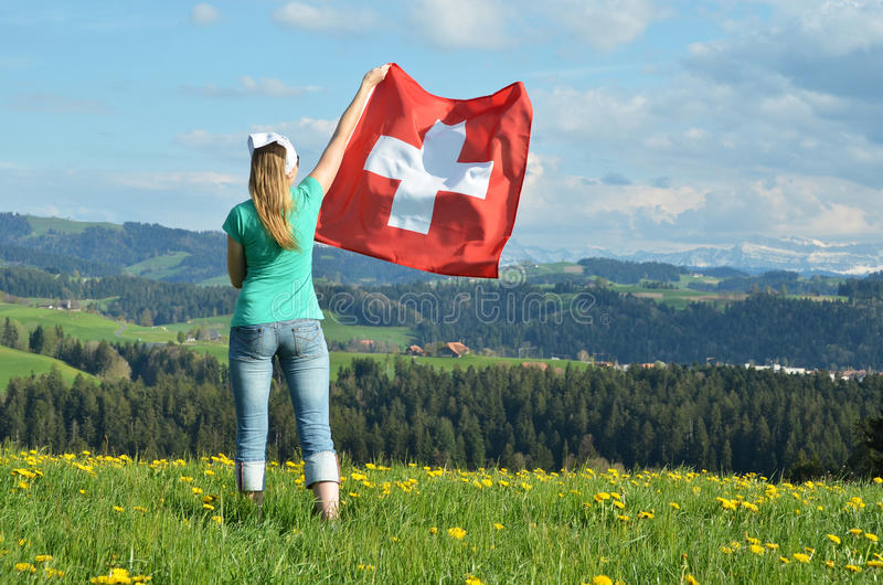 Girl with the Swiss flag. Emmental, Switzerland royalty free stock photo