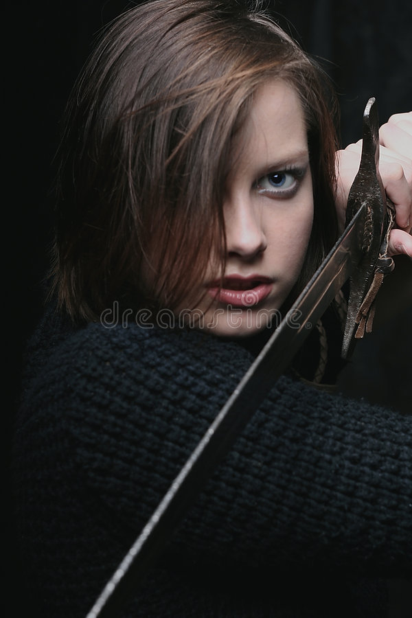 Girl with sword royalty free stock images