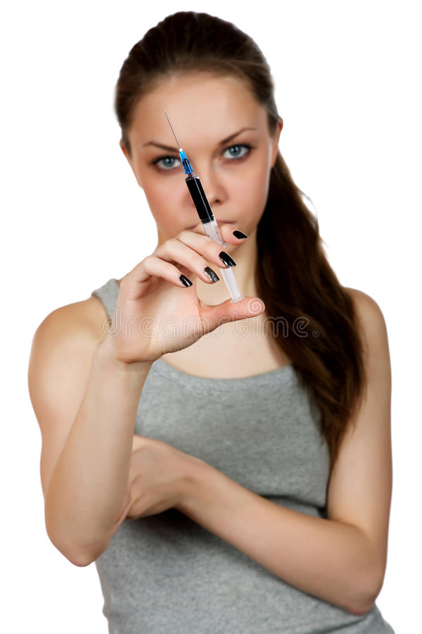 Girl about a syringe in hand stock images
