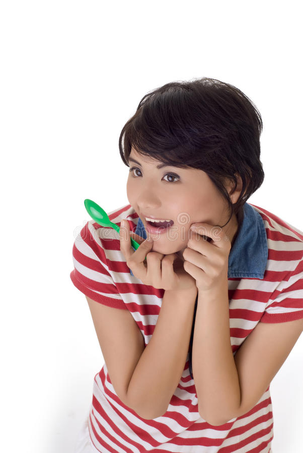 Download Girl With Tablespoon With Exciting Expression Stock Photo - Image: 15343192