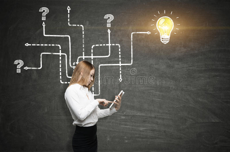 Download Girl With A Tablet And An Arrow Maze Stock Photo - Image: 83722094