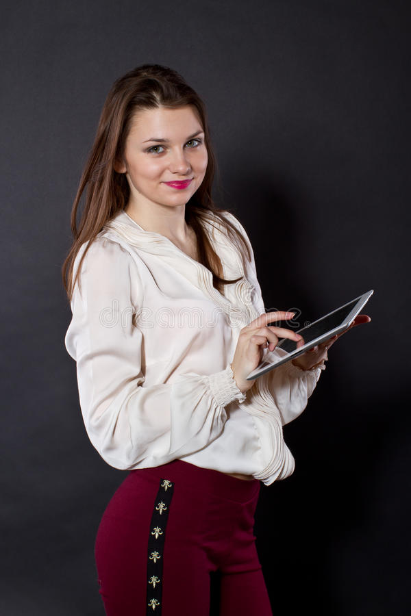 Girl with a Tablet PC royalty free stock photography