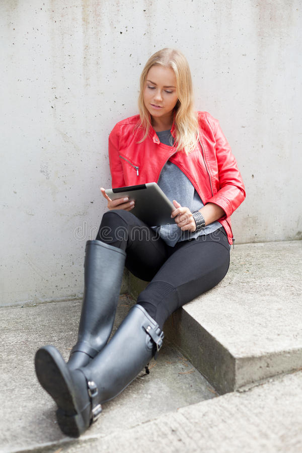 Girl with tablet pc. Grunge girl with tablet computer stock image