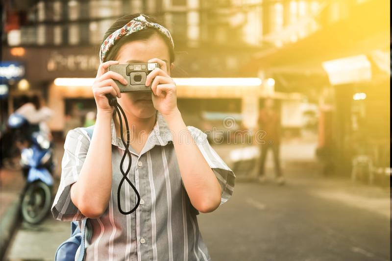 A girl take a picture. By vintage film camera stock photography