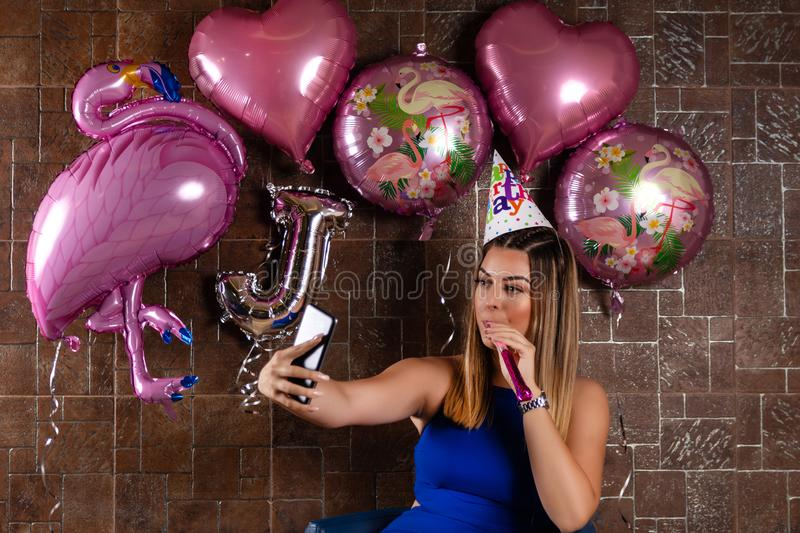 Girl takes a selfie with the phone at the birthday party royalty free stock photo