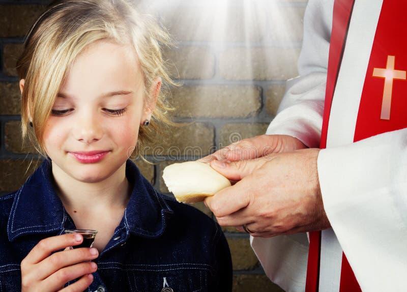 Girl taking Communion royalty free stock photo