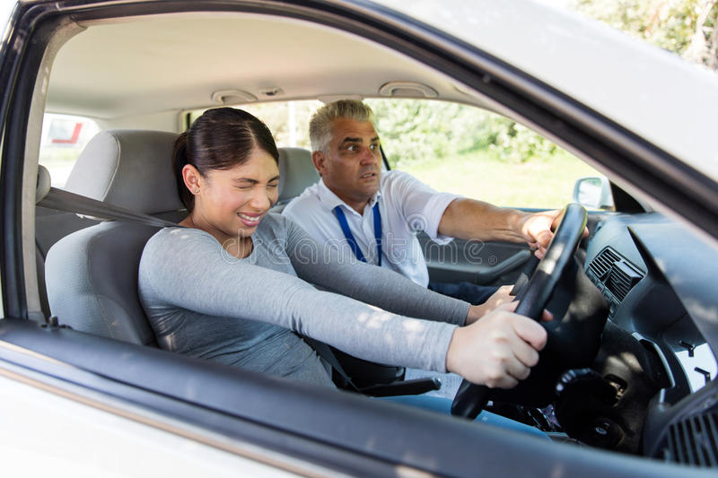 Girl taking driving lessons stock photo