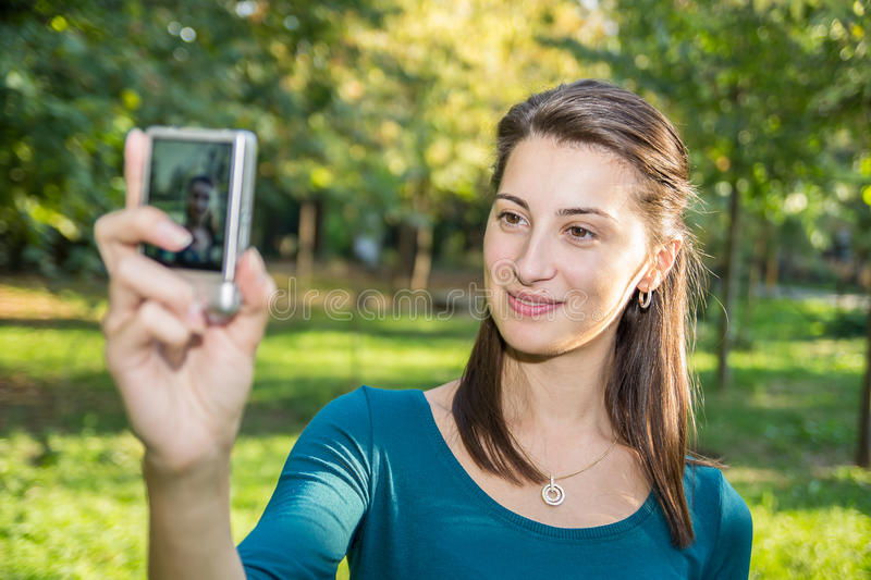 Download Girl Taking Photos stock image. Image of brunette, cheerful - 26983137