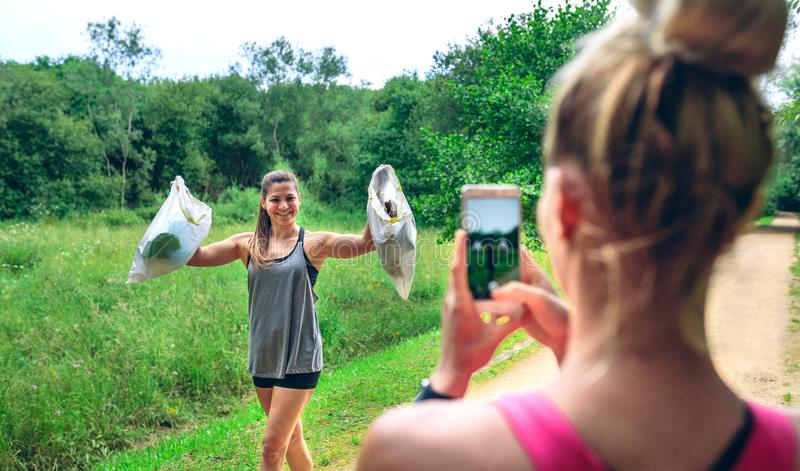 Girl taking picture of a friend after plogging royalty free stock images