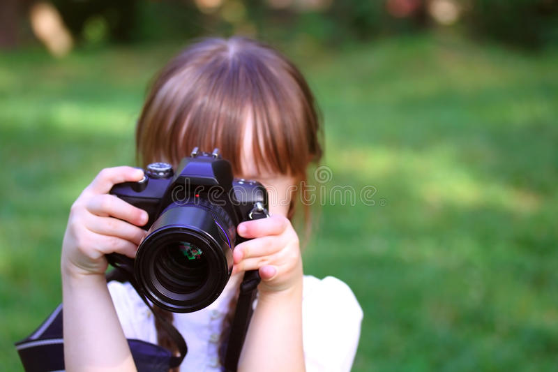 Girl taking pictures stock photos