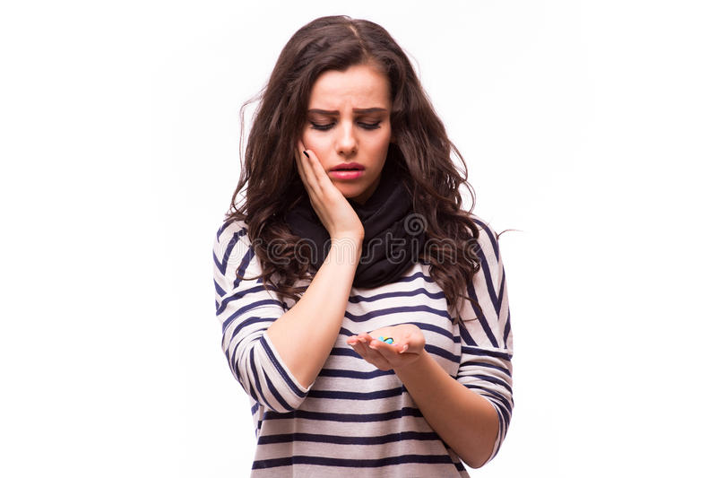Girl taking pills from head pain, cough, illness stock image