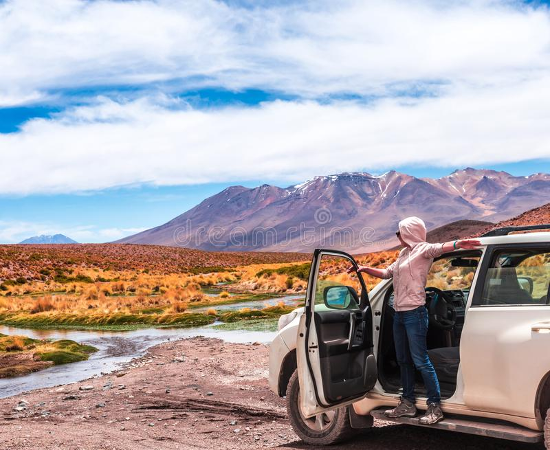 Girl taking pleasure of Bolivian landscape stock photos
