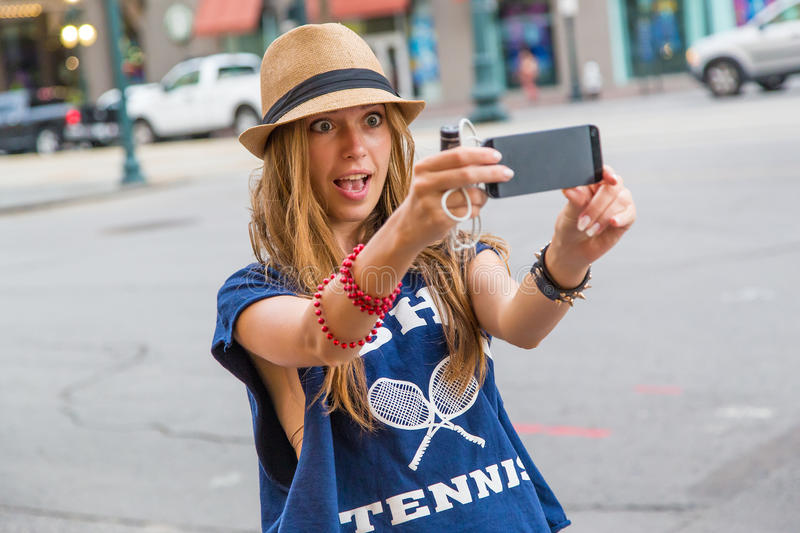 Girl taking a selfie royalty free stock image