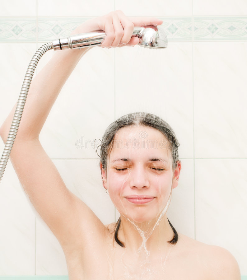 Girl taking a shower stock image. Image of relax