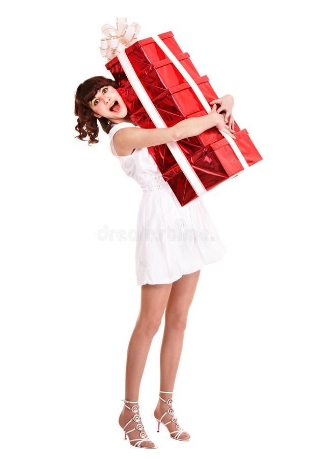 Girl taking stack of gift box. stock photo
