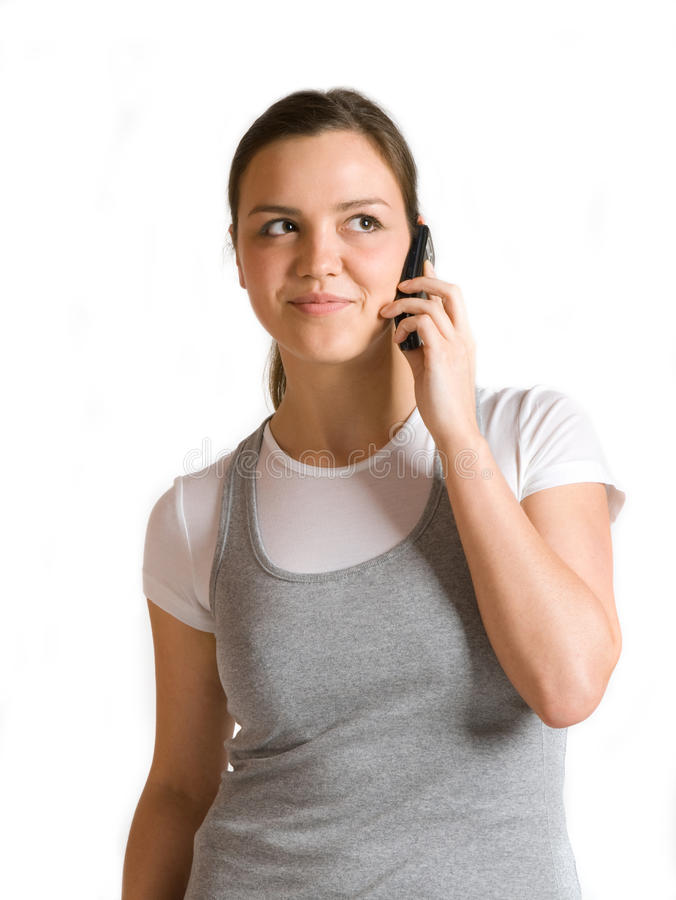 Girl talking on a mobile phone royalty free stock photo