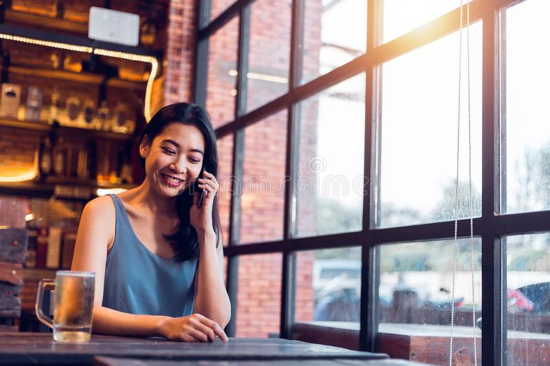 A girl talking on the phone in a brewery happily royalty free stock photography