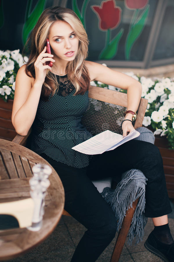 A girl talking on the phone royalty free stock photography
