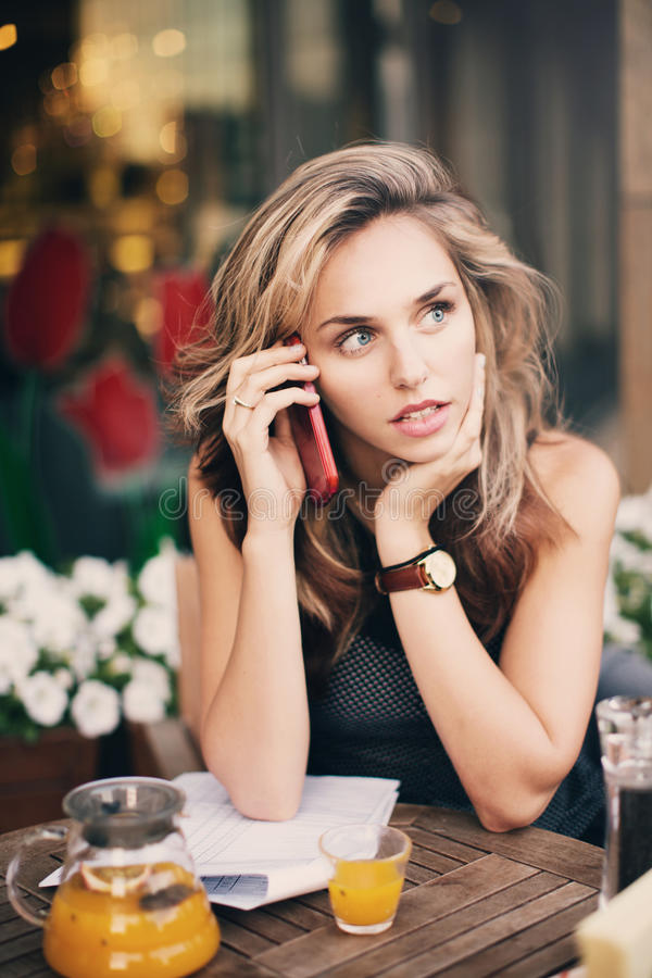 A girl talking on the phone stock photo