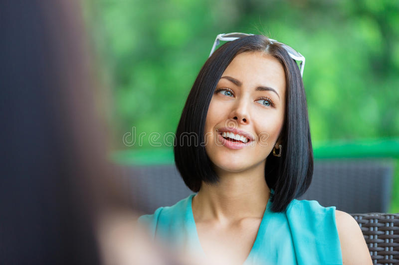 Download Girl Talks With Friend Sitting At The Bistro Stock Image - Image: 33586289
