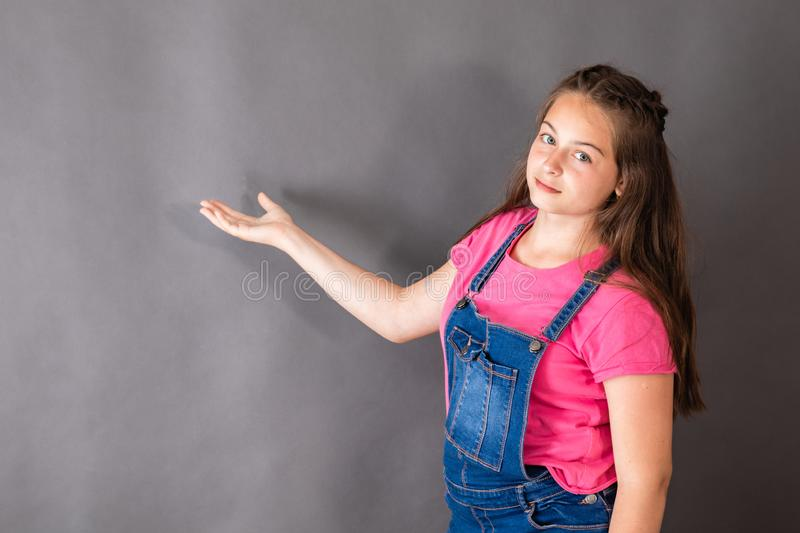 The girl talks over the task and gesticulates. With hand stock images
