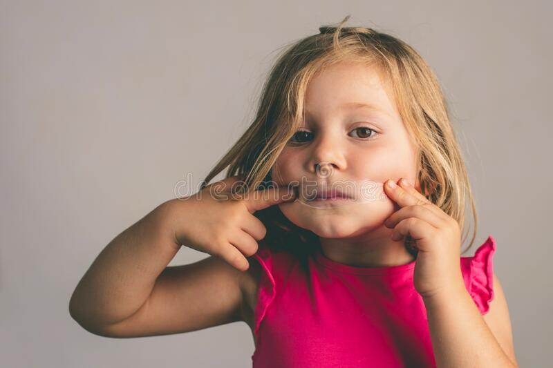 Girl with a tape closing her mouth royalty free stock photography