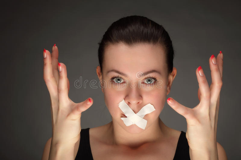 Download Girl With Tape On Lips Royalty Free Stock Image - Image: 24568206
