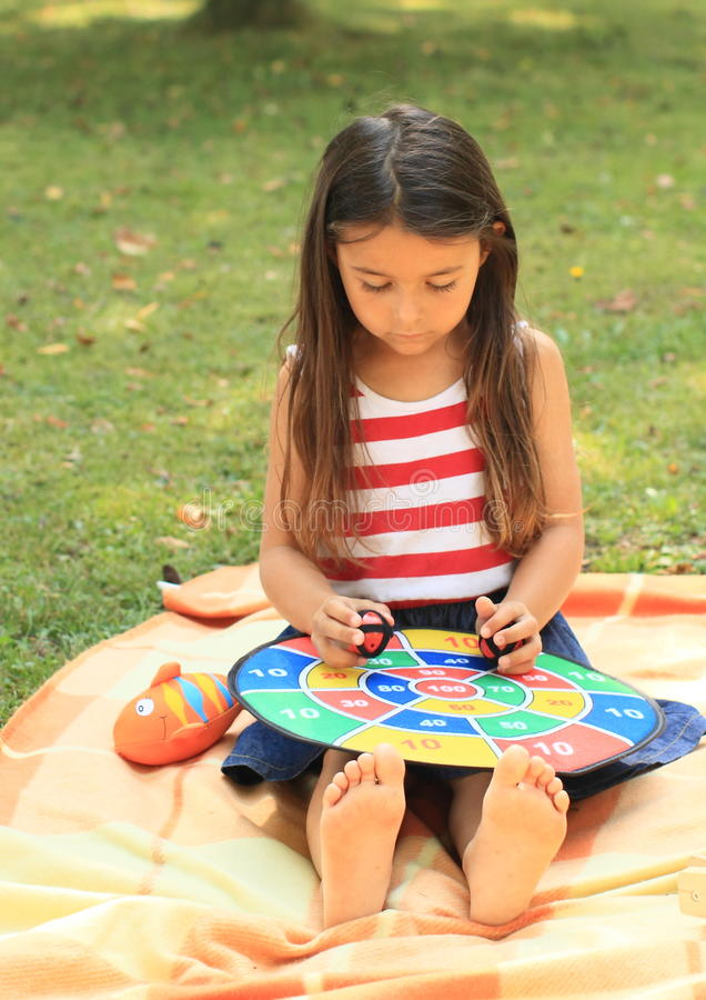 Download Girl with target stock photo. Image of color, girl, playing - 33269500