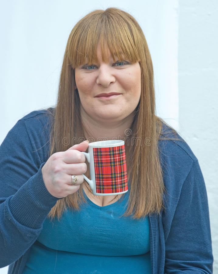 Download Girl with tartan mug. stock image. Image of knitted, attractive - 22997993