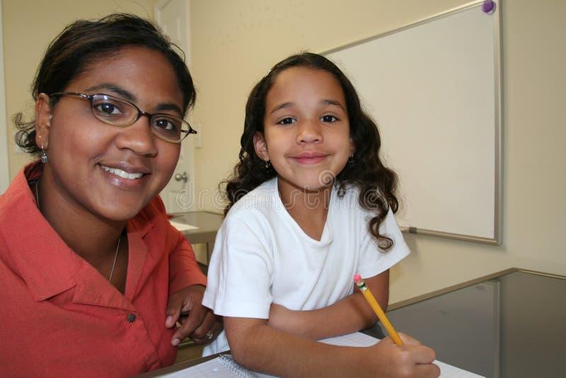 Girl and Teacher stock photo