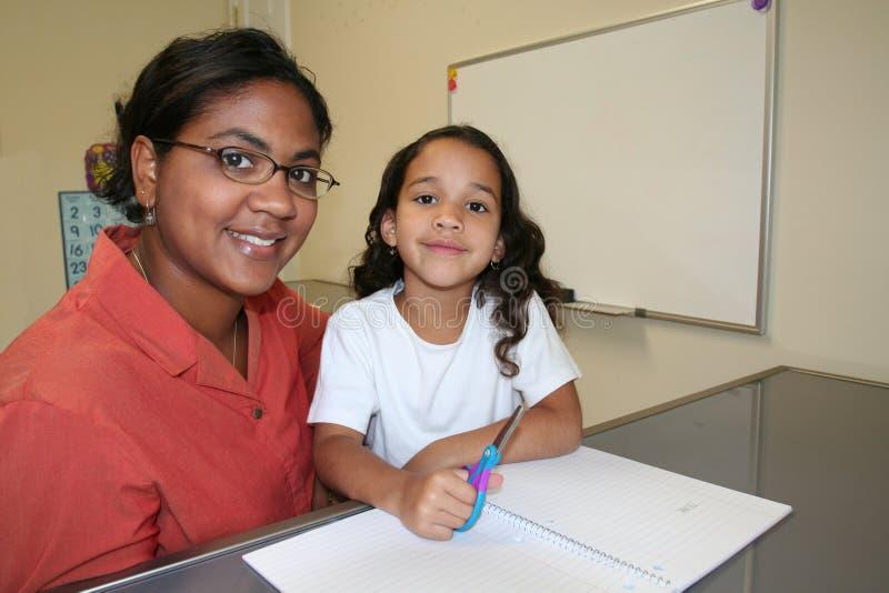 Girl and Teacher stock image