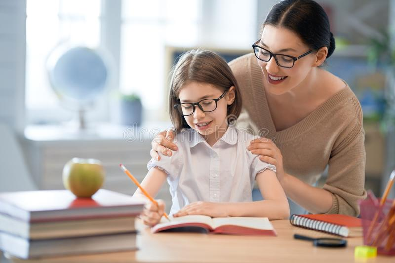 Girl with teacher in classroom royalty free stock images