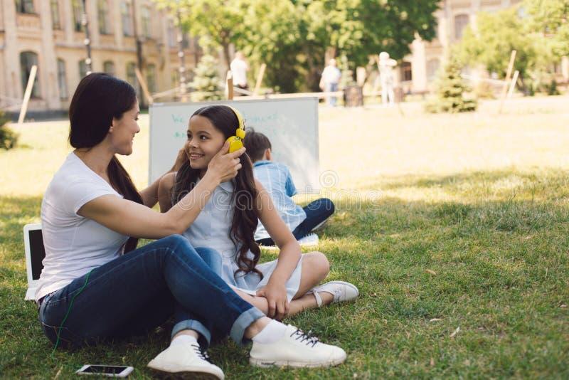 Children and teacher enjoy in park stock photography