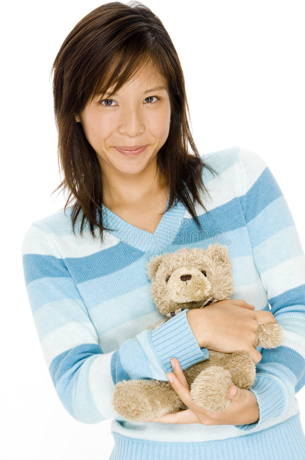 Girl and Teddy. A cute young asian woman with a teddy bear stock photos