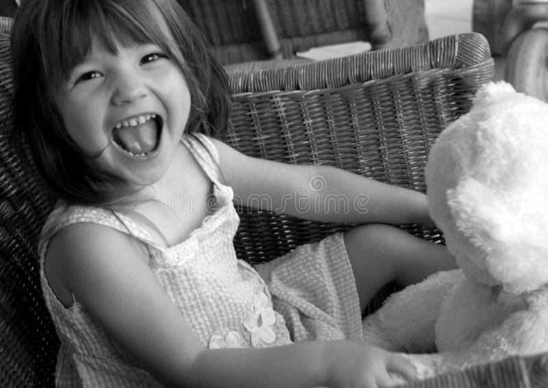 Download Girl with teddy bear stock image. Image of laugh, precious - 225887