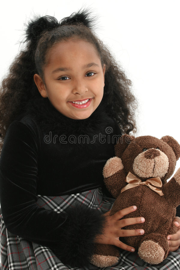 Girl with teddy bear. Cute smiling girl holding her teddy bear, on white studio background stock image