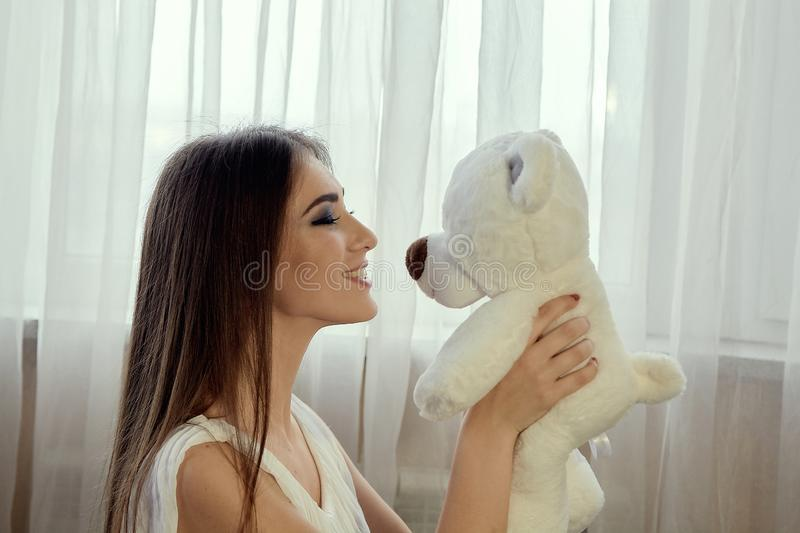 Girl with teddy bear for lifestyle design.Young caucasian model. Beautiful woman face. Girl with teddy bear for lifestyle design. Young caucasian model stock photo